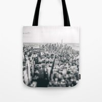 new york skyline Tote Bags featuring New York City Skyline by Vivienne Gucwa