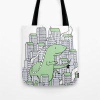 godzilla Tote Bags featuring Godzilla by Mild Peril Media