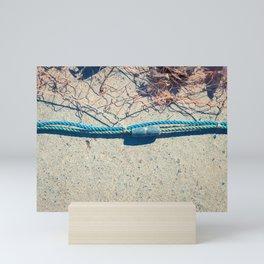Fishnet with sinker on rope Mini Art Print