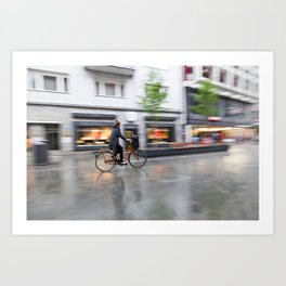 young woman on her bicycle traveling in the rain Art Print