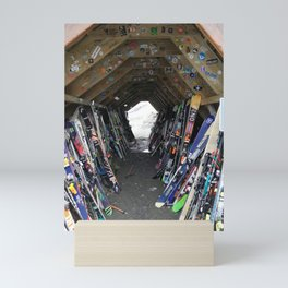 Hideout gathering of skis Mini Art Print