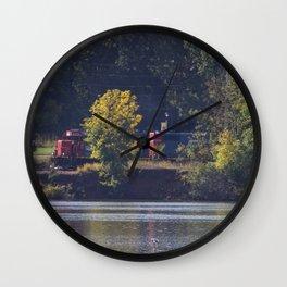 Train traveling along river Wall Clock