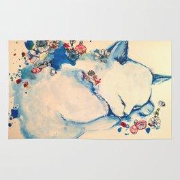 Cat sleeping with flowers Rug