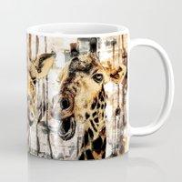 giraffes Mugs featuring Giraffes by RIZA PEKER