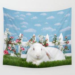 White lop eared bunny in a flower garden Wall Tapestry