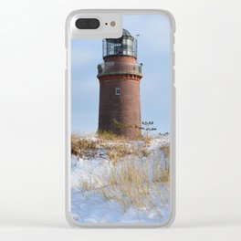 Sturdy Lighthouse on a Rocky Coast in Winter Clear iPhone Case