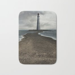 Cloudy seascape with an older lighthouse Bath Mat