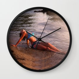 Beautiful young woman on a beach near sea Wall Clock