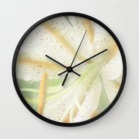 lily Wall Clocks featuring Lily by Deepti Munshaw