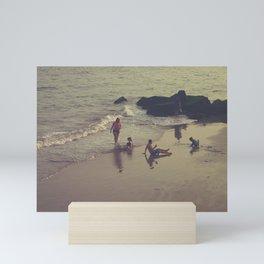 Family Plays on the Rocky Beach Mini Art Print