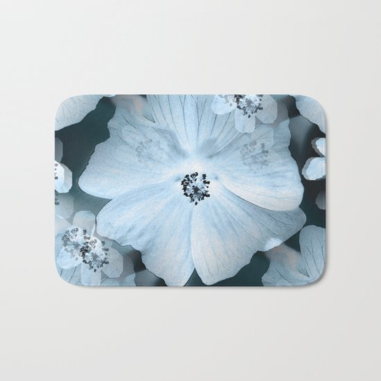 Flower-power - pastel blue flowers on a dark blue background Bath Mat
