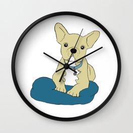 Puppy on a pillow Wall Clock