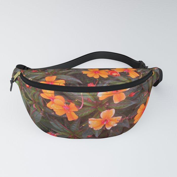 Garden orange flowers Fanny Pack