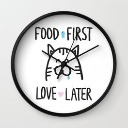 Food first, love later Wall Clock