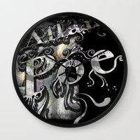 edgar allan poe Wall Clocks featuring Edgar Allan Poe by Irmak Akcadogan