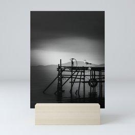 Seagull sitting on a quay Mini Art Print