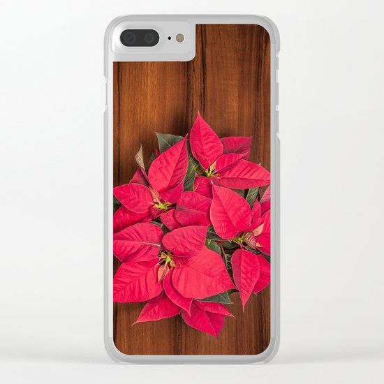 Red Christmas flower on brown wood Clear iPhone Case