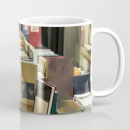 Old books stacked on a table in the street for sale. Coffee Mug