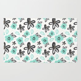 Mint and black flowers Rug