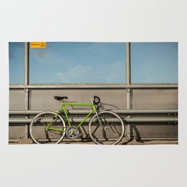 Green Bike on a Bridge Rug