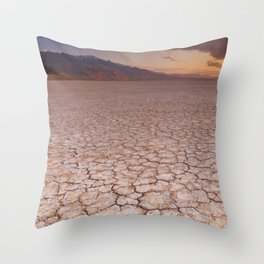 I - Cracked earth in remote Alvord Desert, Oregon, USA at sunrise Throw Pillow
