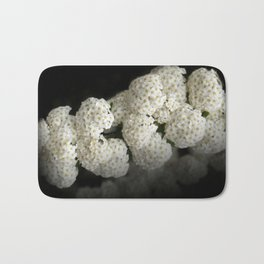 little snowballs on black Bath Mat