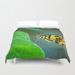 Butterfly , cute insect with multicolor colored wings sitting on green leaf on natural background. W Duvet Cover