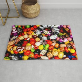 A Pile Of Colorful Decorative Beads Rug