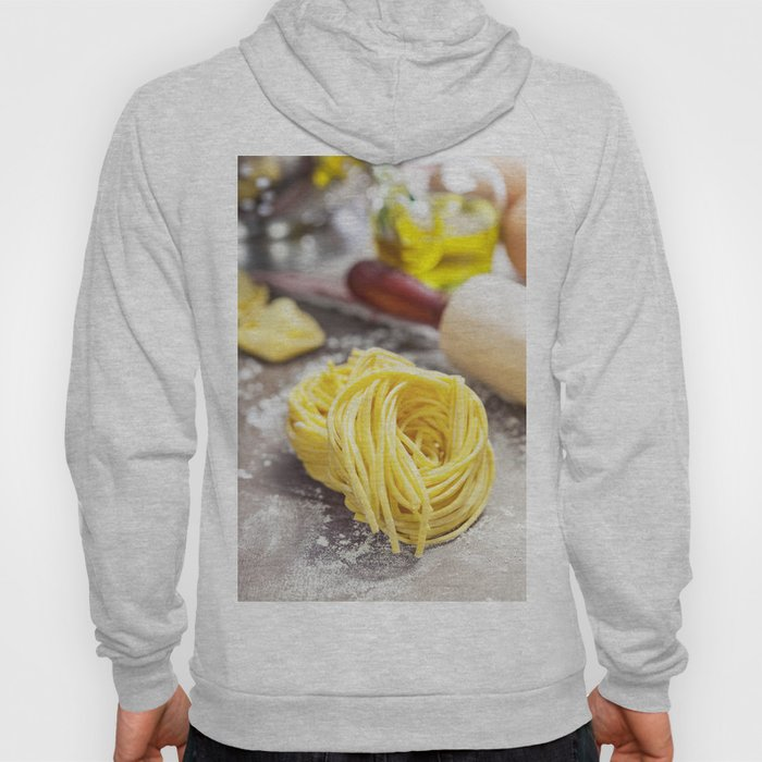 Making homemade pasta on wooden table Hoody