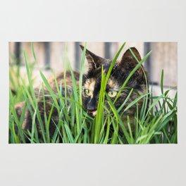Cat in grass Rug