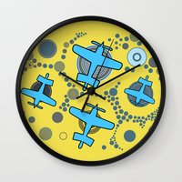 airplanes Wall Clocks featuring blue airplanes by Isabella Asratyan