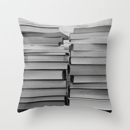 Black and white image of some books stacked on a shelf Throw Pillow