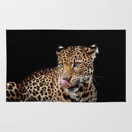 Leopard portrait on dark background Rug