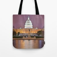 washington dc Tote Bags featuring Glowing Washington DC Capitol by Nicolas Raymond