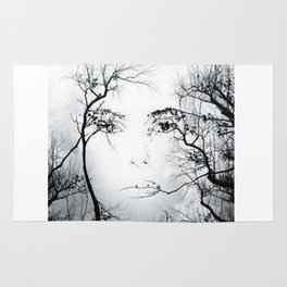 face in the trees Rug