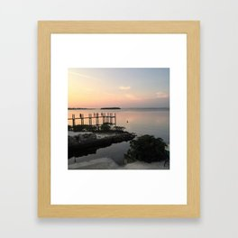 Playing on the pier Framed Art Print