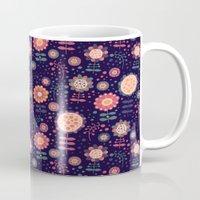 flora Mugs featuring Flora by Valendji