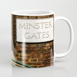Minster gates and Minerva, the goddess of wisdom, in York, England Coffee Mug
