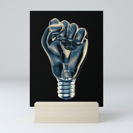 Protest fist light bulb / 3D render of glass light bulb in the form of clenched fist Mini Art Print