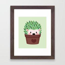 Hedgehogs disguised as cactuses Framed Art Print