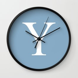Letter Y sign on placid blue background Wall Clock