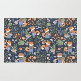 The foxy gardener // orange foxes Rug