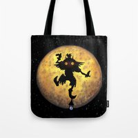 majora Tote Bags featuring majora mask by neutrone