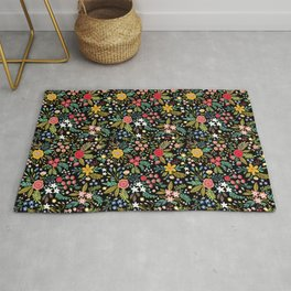 Amazing floral pattern with bright colorful flowers, plants, branches and berries on a black backgro Rug