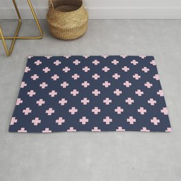 Pink Swiss Cross Pattern on Navy Blue background Rug