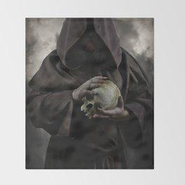 Holding a male skull Throw Blanket