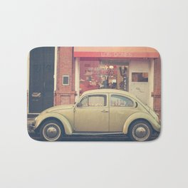 Beige Volkswagen Bug and a lovely Pink Shop (Vintage - Retro Urban Photography) Bath Mat
