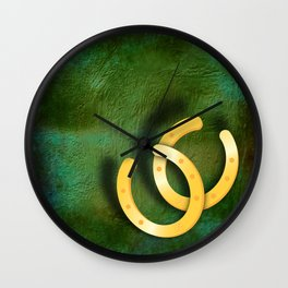 Lucky horseshoes on a textured green background Wall Clock