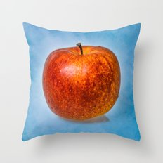 Red apple fruit against light blue background Throw Pillow