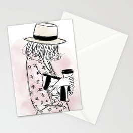 Casual young girl wearing hat and floral dress, clutch bag and a cup of coffee ready to hustle Stationery Cards
